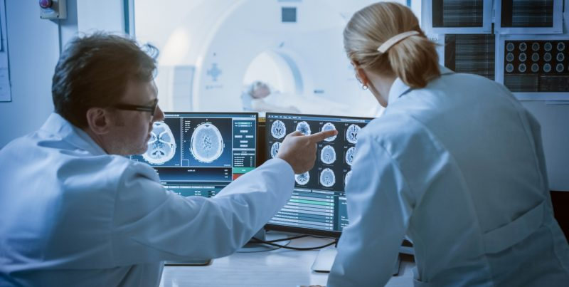 MRI technicians looking at brain from Premier Diagnostic Imaging in Cookeville, TN